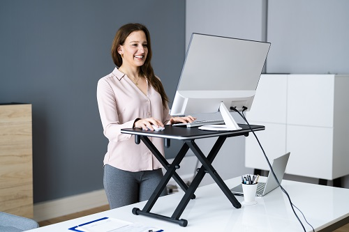 Lady working at computer whilst standing
